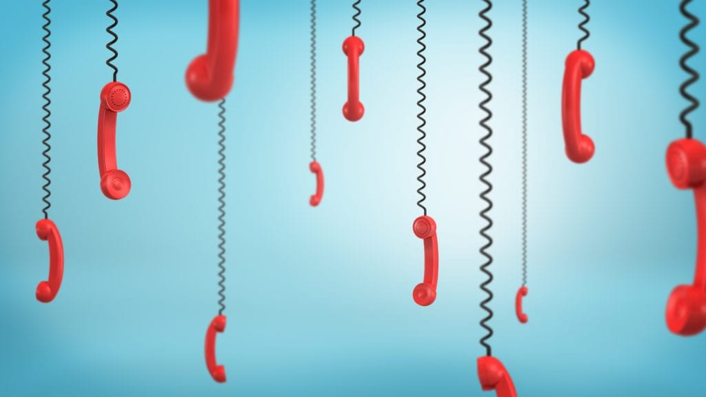 3d rendering of red retro phone receivers hang down from black cords on a blue background. Business and communication. Emergency number. Customer's support.
