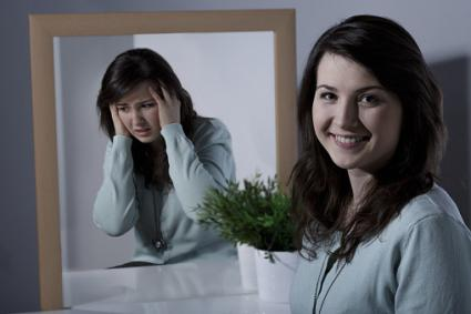 girl in mirror with bipolar