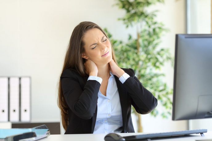 girl at desk with stiff neck