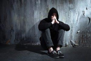 kid in hoodie depressed