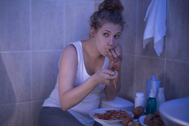 eating food shamefully in bathroom