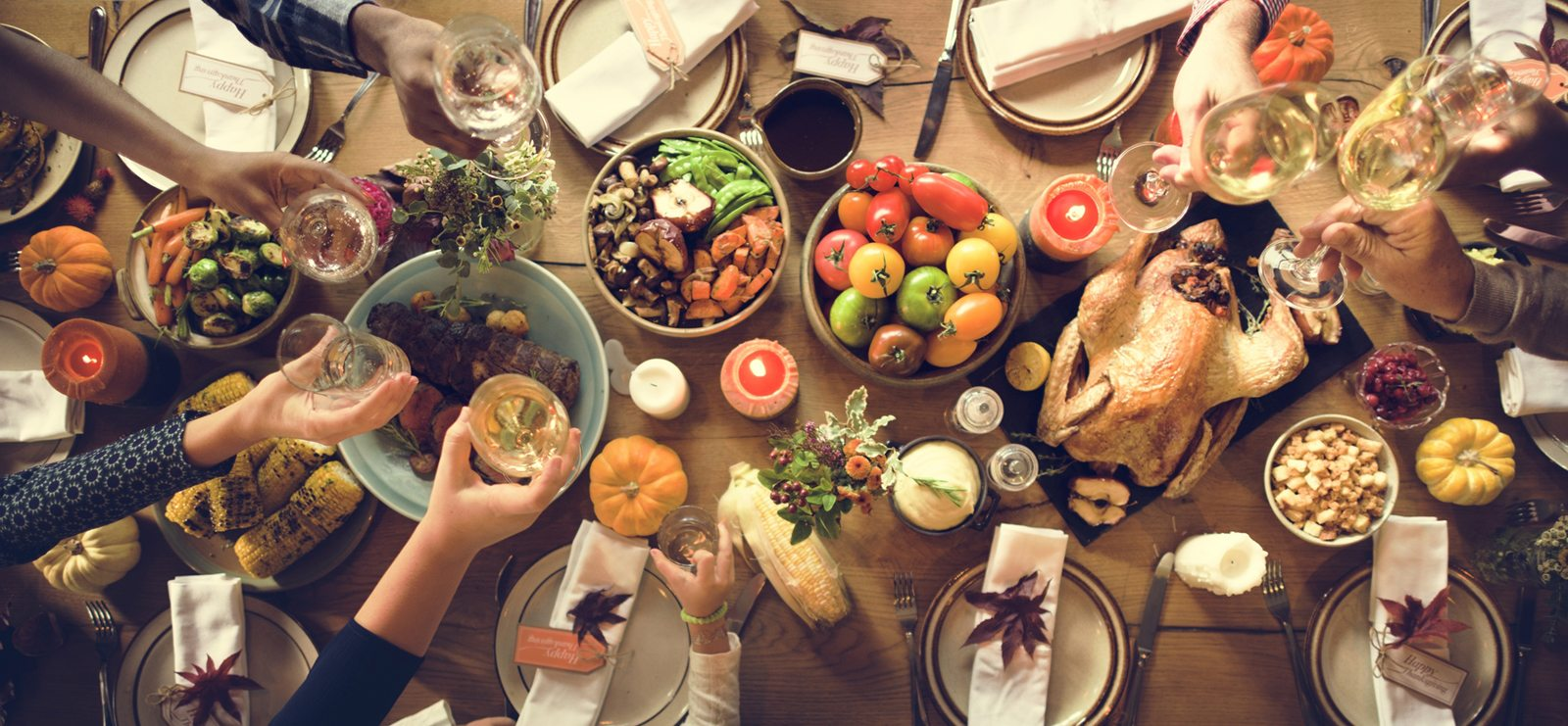 Thanksgiving table spread with a toast
