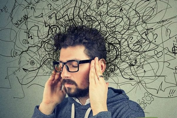 man with adhd trying to concentrate with too many distractions