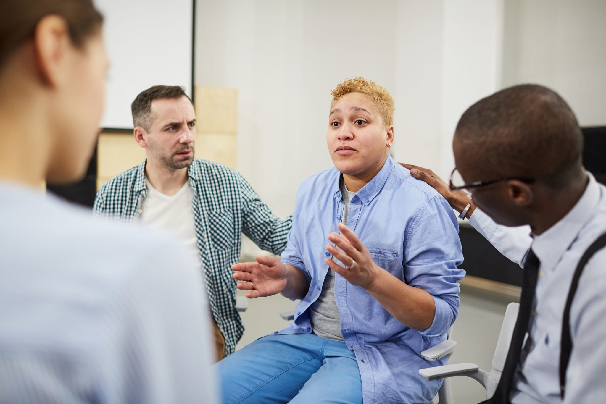 Mixed race woman in group therapy setting