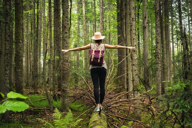 Woman In Forest Nature In Vacation. Woman In Nature. Green Fores