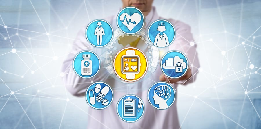medical symbols floating in front of a doctor