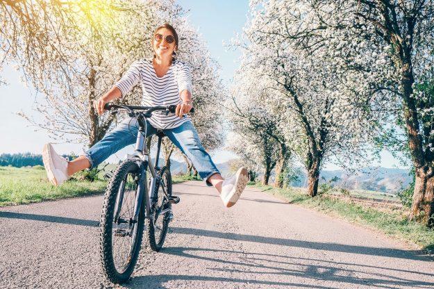 Happy Smiling Woman Riding a Bike