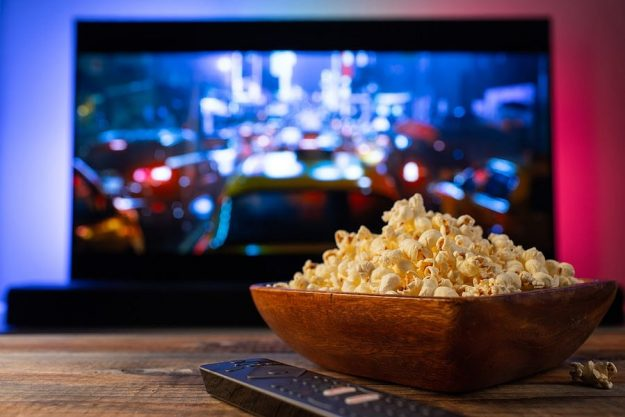 watching movies at home while eating popcorn