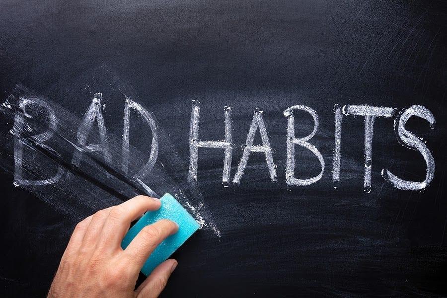 "Person Erasing ""Bad Habits"" on Chalkboard"