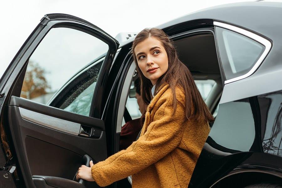 Woman Exiting Car